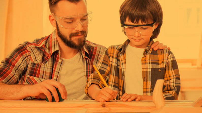 Father working with son on woodworking project